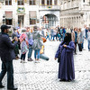 Man taking his wife's picture, Grand Place, Brussels, Belgium