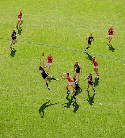 Carlton v. Melbourne, Aussie rules football.