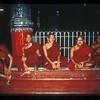 Monks after nightfall at the Shwedagon pagoda, Rangoon, Burma.