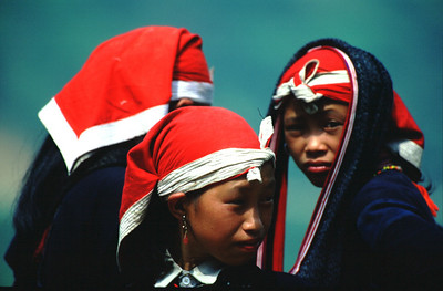 Hill tribe girls selling snacks at a roadside diversion, Sa Pa, Vietnam.