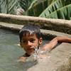 Boy swims in canal, Misfat Al Abreyeen, Oman.