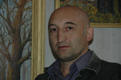 Painter from Vladikavkaz, North Ossetia, Russia, in Kazbegi, Republic of Georgia.