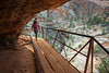 Zion, Canyon Overlook - Woman entering cave on boardwalk