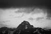 Rainier, Tipsoo - Distant peak under dark skies, black and white
