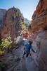 Zion, Angel's Landing - Woman descending into notch before summit