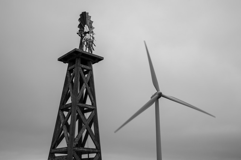 Kittitas, Wild Horse - An old style windmill with a modern windmill, black and white