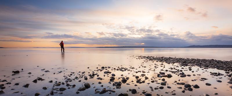 Edmonds, Marina Beach Park - Man standing in calm water at sunset, panoramic