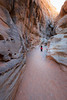 Valley of Fire, White Domes Slot Canyon - Little girl pausing at entrance to slot