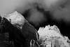 Zion, Angel's Landing - Clouds above distant mountain formations, black and white