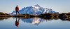 Whatcom, Yellow Aster Butte - Man standing next to small tarn looking at Mt. Shuksan, panoramic
