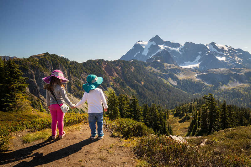 Whatcom, Artist Point - Two little kids holding hands looking at valley and Mt. Shuksan
