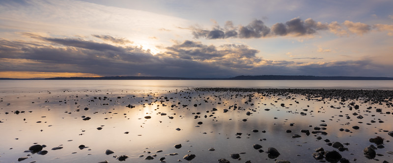Edmonds, Marina Beach Park - Submerged pebbles at sunset in calm water
