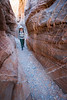 Valley of Fire, Kaolin Slot Canyon - Woman hiking through canyon