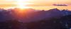Harts Pass, Slate Peak - Sun setting behind distant peaks, panoramic