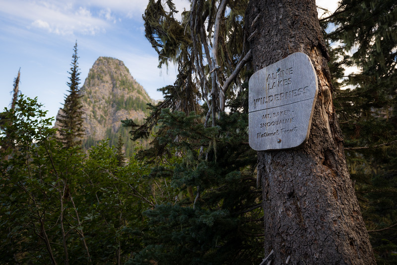 Snoqualmie Pass, PCT North - Alpine Lanes Wilderness boundary sign with Guye Peak in the background