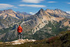 Rainy Pass, Cutthroat Pass - Man standing looking over valley at Hinkhouse Peak, close up