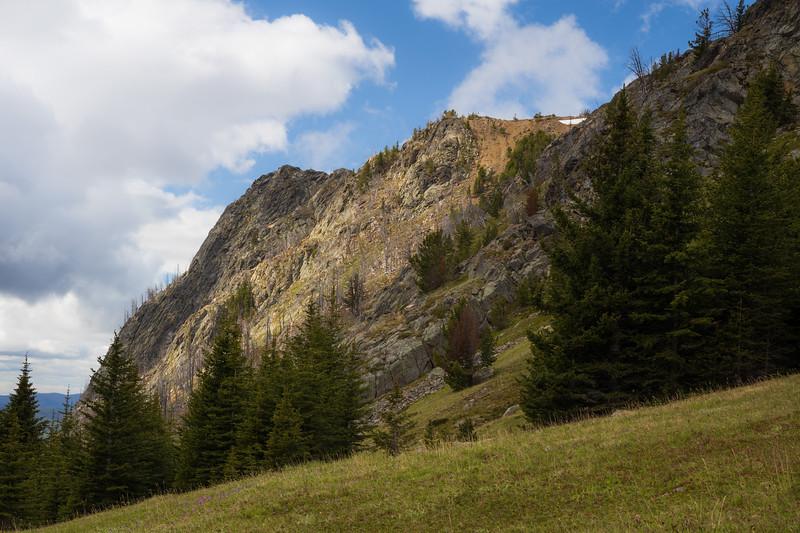Pasayten, Horseshoe Basin - Cliffs above trail illuminated by sunlight