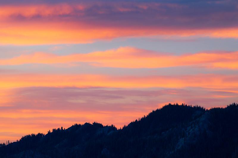 Stuart, Ingalls - Bands of color at sunrise above distant ridge