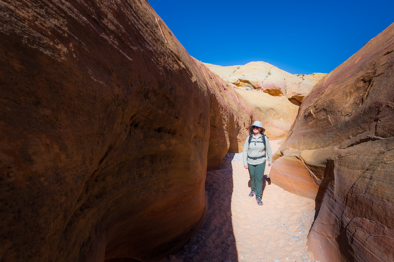Valley of Fire, Pink Canyon - Woman hiking through Pink Canyon