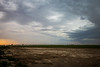 Columbia, Othello - Approaching supercell over farming equipment, different view
