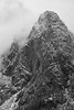 Snoqualmie Pass, Ski Area - Guye Peak in fog and clouds, black and white, vertical