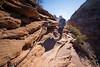 Zion, Angel's Landing - Woman descending chains near base of climb