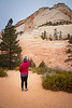 Zion, East Side - Woman taking photo of sandstone formation