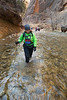 Zion, The Narrows - Woman hiking in the river near end of Riverside Walk