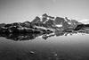 Whatcom, Artist Point - Pond ringed by rocks with Mt. Shuksan on a sunny day, black and white