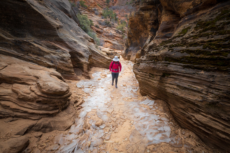 Zion, Clear Creek - Woman walking through icy section