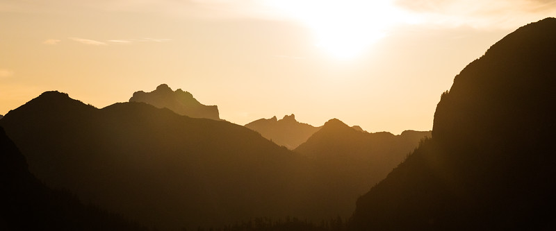 Whatcom, Winchester Mountain - Overlapping mountain ridges backlit by rising sun