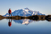 Whatcom, Yellow Aster Butte - Man standing next to small tarn looking at Mt. Shuksan