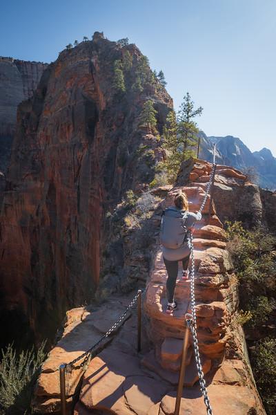 Zion, Angel's Landing - Woman climbing Step of Faith