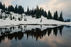 Rainier, Tipsoo - Upper Tipsoo Lake in the snow clouds reflected at sunset, close perspective