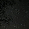 Early attempt at time-lapse photography of night sky.  The tripod moved at the beginning.