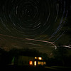 Night Sky Looking North. Multiple exposures (each 15 seconds and 1 minute apart)sandwiched together in Photoshop.  Aeroplane lights left in.