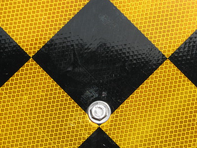 Sign  Close-up of the reflective surface of a traffic sign.