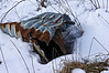 Smashed and rusted culvert under snow