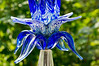 "D249-2012 Detail of a taller art glass garden ornament in a flower beds near the Lithophane Museum.<br /> A fuller, though still incomplete, view of this work can be seen here:  <a href=""http://smu.gs/Q1bu4t"">http://smu.gs/Q1bu4t</a><br /> .<br /> Toledo Botanical Garden, Ohio.<br /> September 6, 2012."