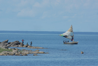 Boat with home made sail and boys, Lake Malawi.