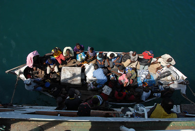 Passengers disembark at a local stop too small for the MV Ilala to dock, Malawi.