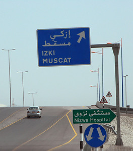 Traffic and signs, Nizwa, Oman.