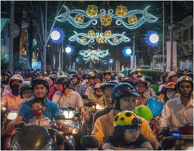 Playing in Traffic, Saigon, Vietnam.