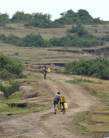 Carrying petrol cans near Lake Edward, Uganda.