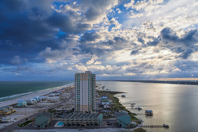 The west side of Gulf Shores, Alabama, looking west through afternoon clouds.