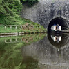 EXITING CHIRK TUNNEL ON THE  LLANGOLLEN CANAL by John Burnett