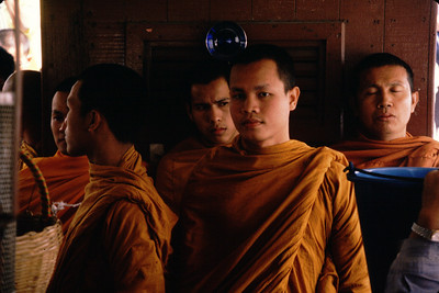 Monks on ferry boat, Chao Praya river, Thailand.