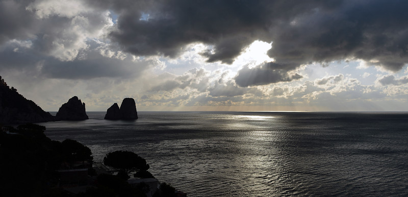 Stormy skies over sea stacks (faraglioni) at Capri, Italy