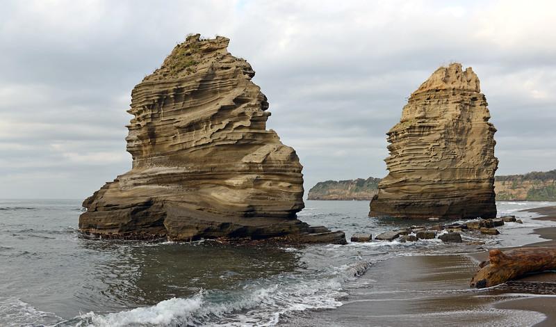 Sea stacks of layered volcanic tuffs along the north coast of Procida island, Italy