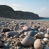 Pebbly beach and limestone cliffs north of Dibab, Oman
